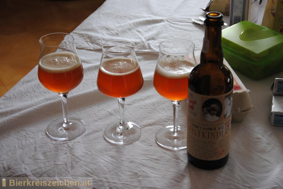 Foto eines Bieres der Marke Stiegl Hausbier - Christkindl aus der Brauerei Stieglbrauerei