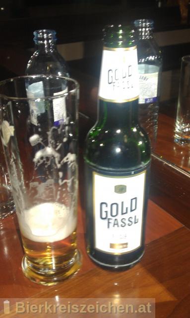 Foto eines Bieres der Marke Ottakringer - Gold Fassl - Pils aus der Brauerei Ottakringer Brauerei