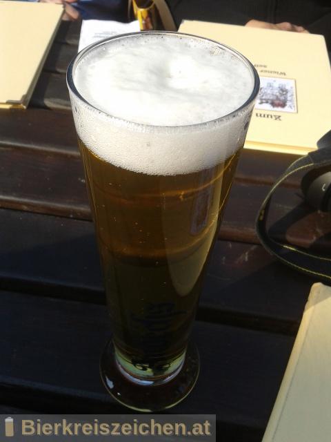 Foto eines Bieres der Marke Andechser Vollbier Hell aus der Brauerei Klosterbrauerei Andechs