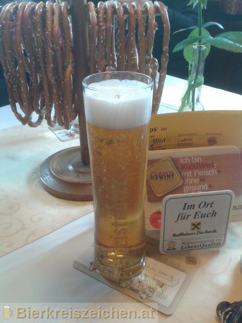 Foto eines Bieres der Marke Freistädter Midium aus der Brauerei Braucommune in Freistadt