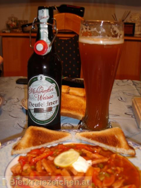 Foto eines Bieres der Marke Neufeldner - Mühlviertler Weisse aus der Brauerei Neufeldner BioBrauerei