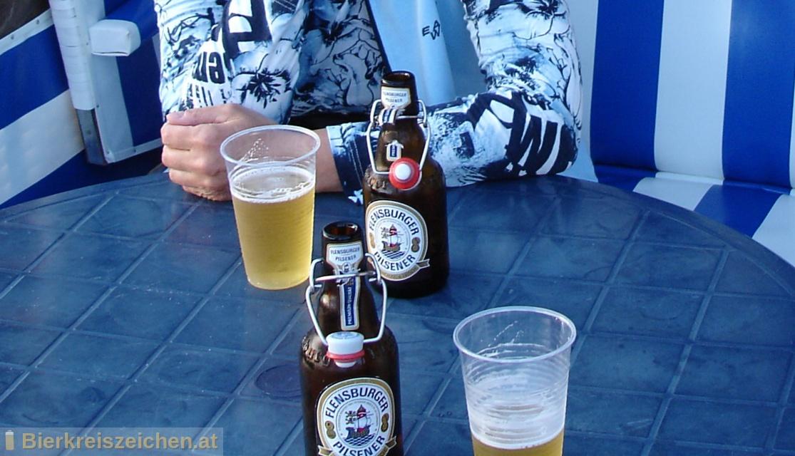 Foto eines Bieres der Marke Flensburger Pilsener aus der Brauerei Flensburger Brauerei