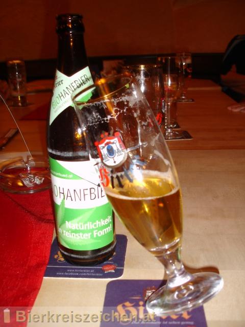 Foto eines Bieres der Marke Hirter Biohanfbier aus der Brauerei Brauerei Hirt
