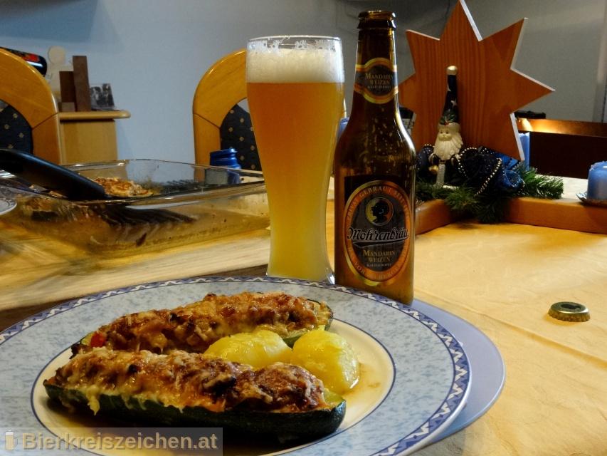 Foto eines Bieres der Marke Mohren Mandarin Weizen aus der Brauerei Mohrenbrauerei
