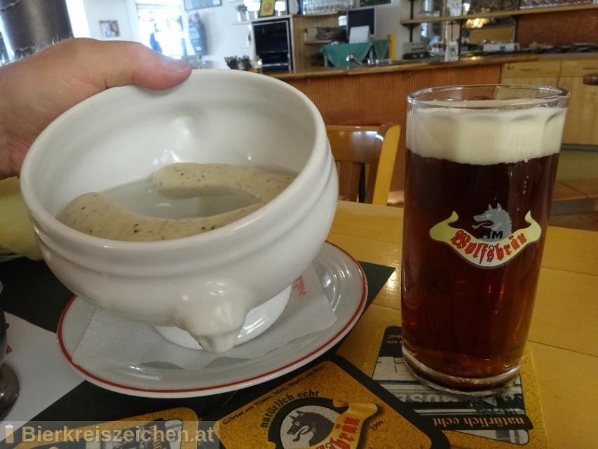 Foto eines Bieres der Marke Wolfsbräu Dunkles aus der Brauerei Wolfsbräu