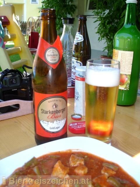 Foto eines Bieres der Marke Starkenberger Gold Lager aus der Brauerei Brauerei Schloss Starkenberg