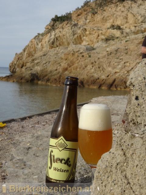 Foto eines Bieres der Marke Flecks Weizen aus der Brauerei Flecks