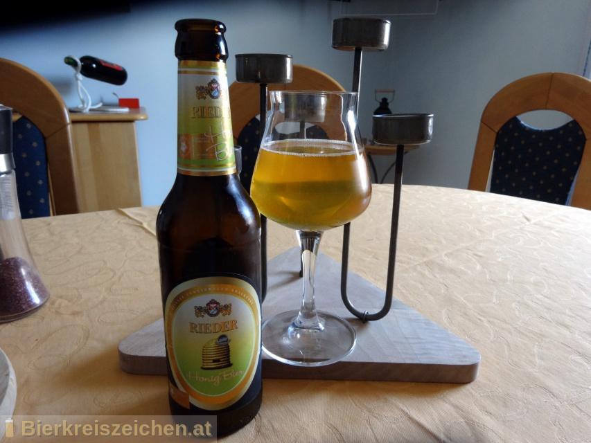 Foto eines Bieres der Marke Rieder Honig Bier aus der Brauerei Brauerei Ried