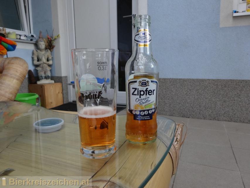 Foto eines Bieres der Marke Zipfer Orangen Radler aus der Brauerei Brauerei Zipf