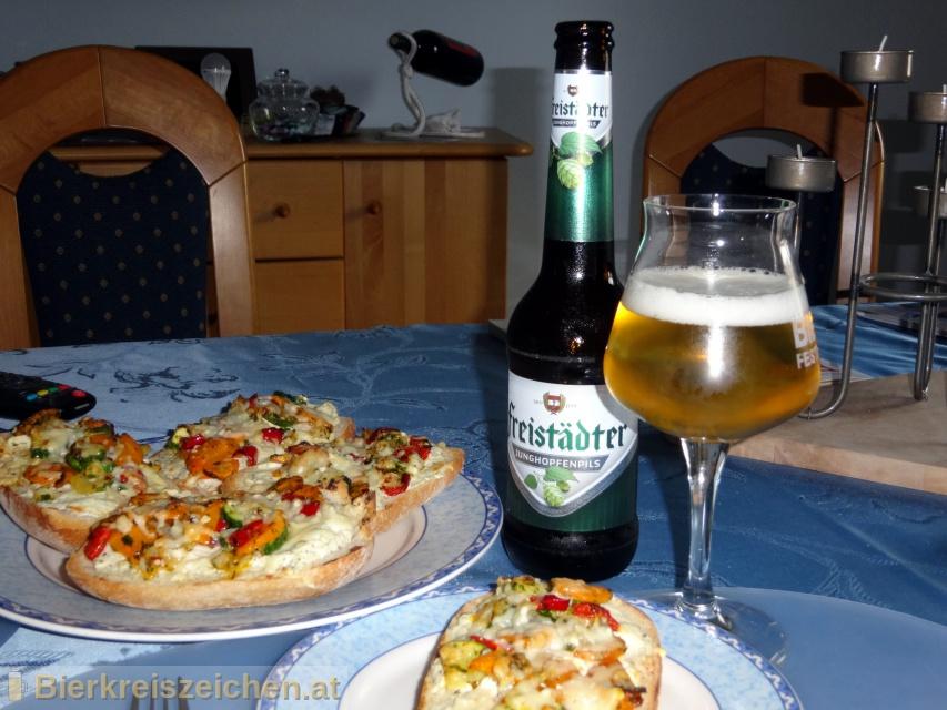 Foto eines Bieres der Marke Freistädter Junghopfen Pils aus der Brauerei Braucommune in Freistadt