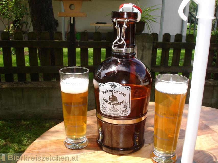 Foto eines Bieres der Marke Weinberger Schlossbräu Hell aus der Brauerei Schloßbrauerei Weinberg