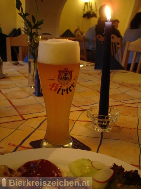 Foto eines Bieres der Marke Hirter Weizen aus der Brauerei Brauerei Hirt