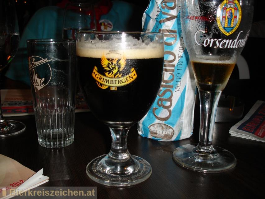 Foto eines Bieres der Marke Grimbergen Dubbel aus der Brauerei N.V. Brouwerijen Alken Maes Brasseries S.A.